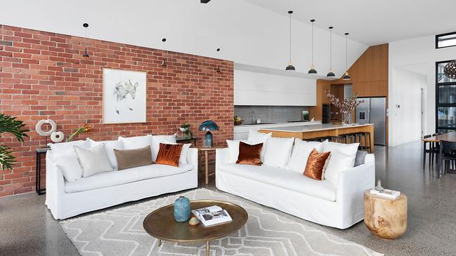 The lounge room with an exposed brick wall.