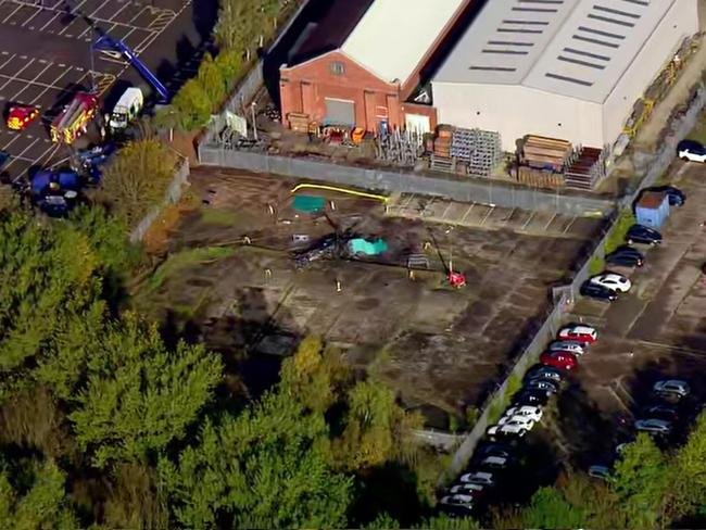 The site of the helicopter crash seen near a carpark by the King Power stadium in Leicester. Picture: AP/Sky News
