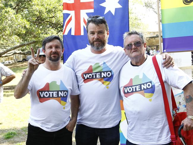 Nick Folkes (middle) stands with supporters. Picture: Danny Casey