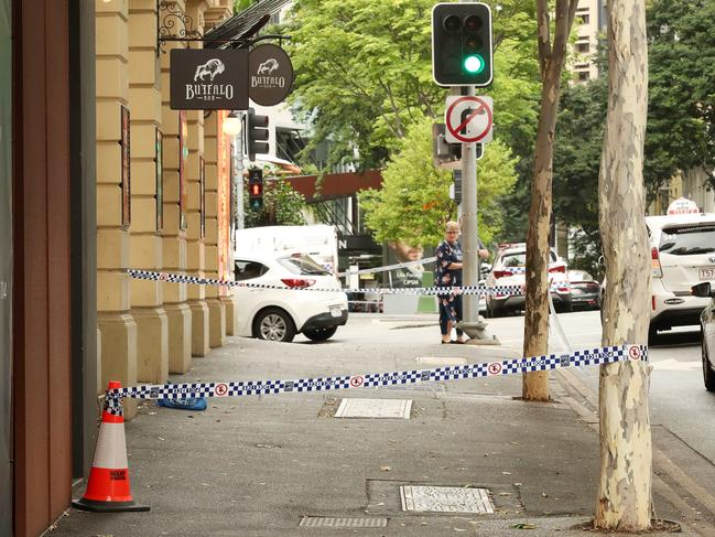 A small crime scene in front of the Buffalo Bar on Mary St. Picture: Liam Kidston