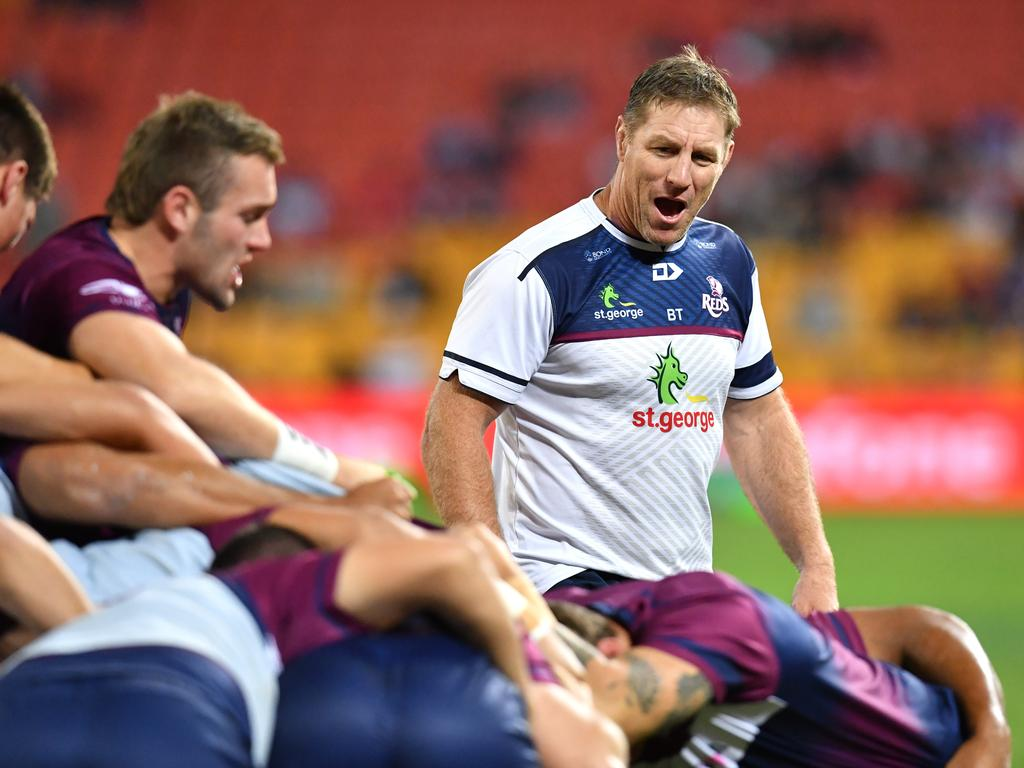 Reds coach Brad Thorn (centre) is seen as his team warms up before the Round 17 Super Rugby match between the Queensland Reds and the Auckland Blues at Suncorp Stadium in Brisbane, Friday, June 7, 2019. (AAP Image/Darren England) NO ARCHIVING, EDITORIAL USE ONLY