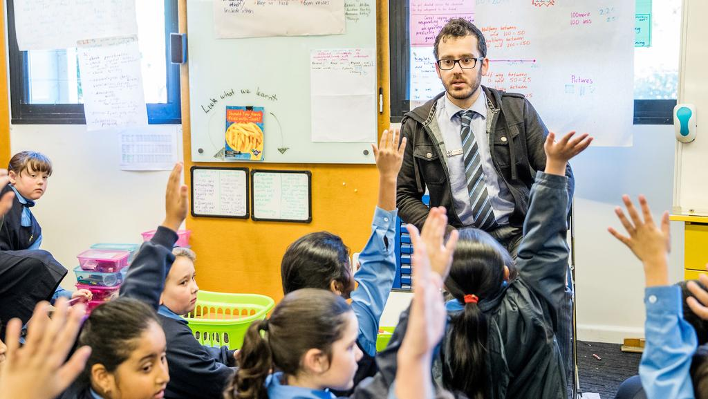 a rare male primary school teacher in the classroom