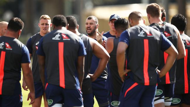 Wallabies coach Michael Cheika talks to his players during training at Moore Park.
