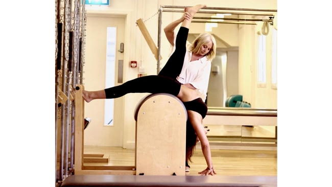 Image: Supplied. Olga Tamara teaching Gaby Noble, owner of Exhale Pilates London and licences of Authentic Pilates Education