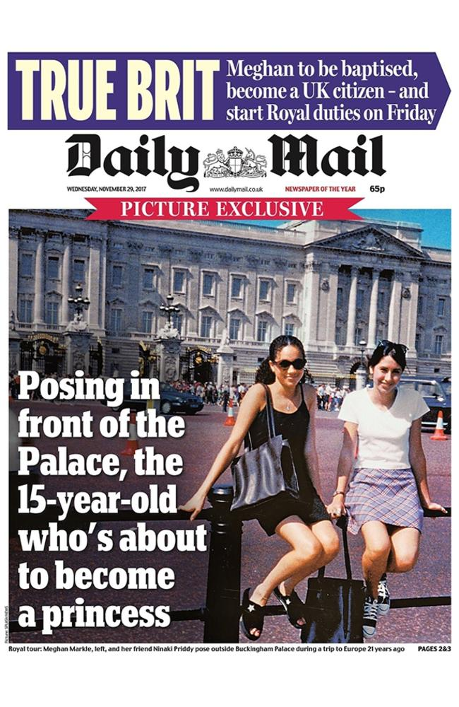 A young Meghan Markle, left, with her childhood best friend Ninaki Priddy posing outside Buckingham Palace. Picture: Splash