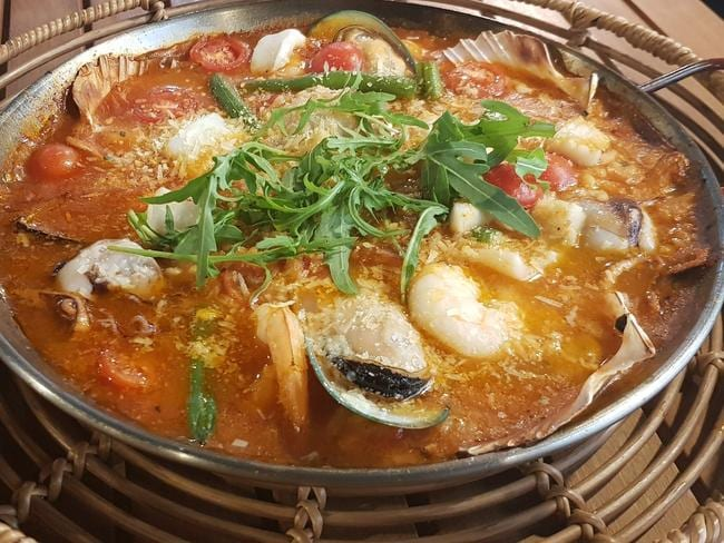 Try the paella at the Old Bar Village Café.