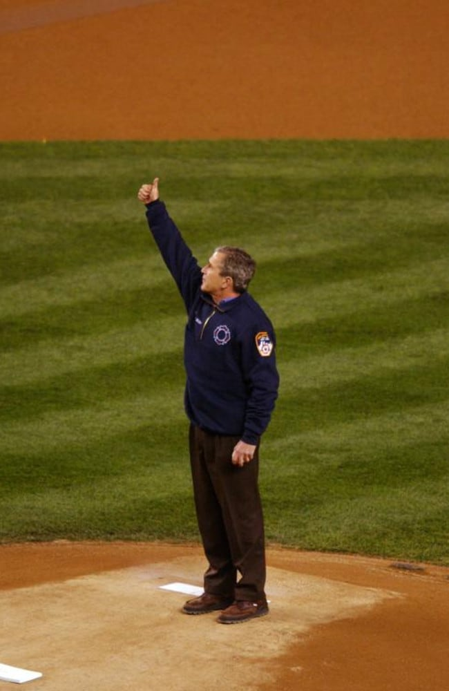 President George W. Bush gives the crowd a thumbs up as he takes the mound to throw out the ceremonial first pitch.