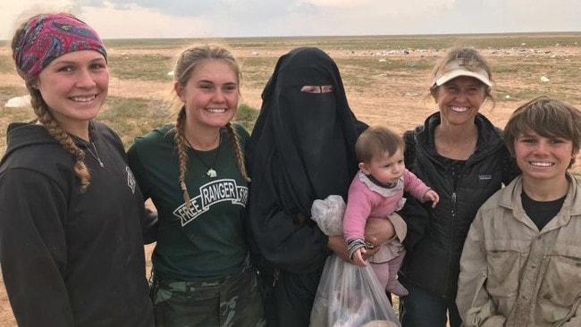 Australian ISIS bride Zehra Duman, centre, with her child and aid workers from the Free Burma Rangers in Syria.