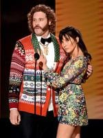 Actors T.J. Miller and Olivia Munn speak onstage during the 2016 American Music Awards at Microsoft Theater on November 20, 2016 in Los Angeles, California. Picture: Getty