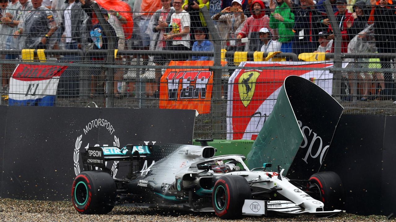 Fans look on as Hamilton crashes out of the lead.