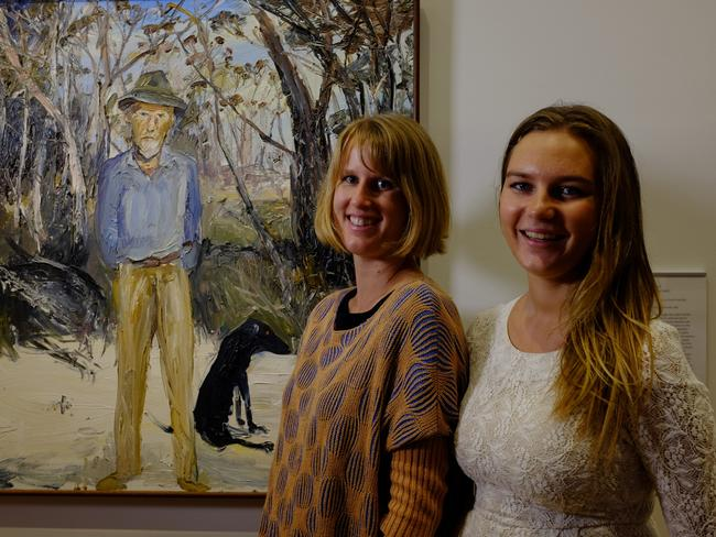 Lauren pictured with her half sister Charlotte in front of portrait of their paternal grandfather, Manning Clark.