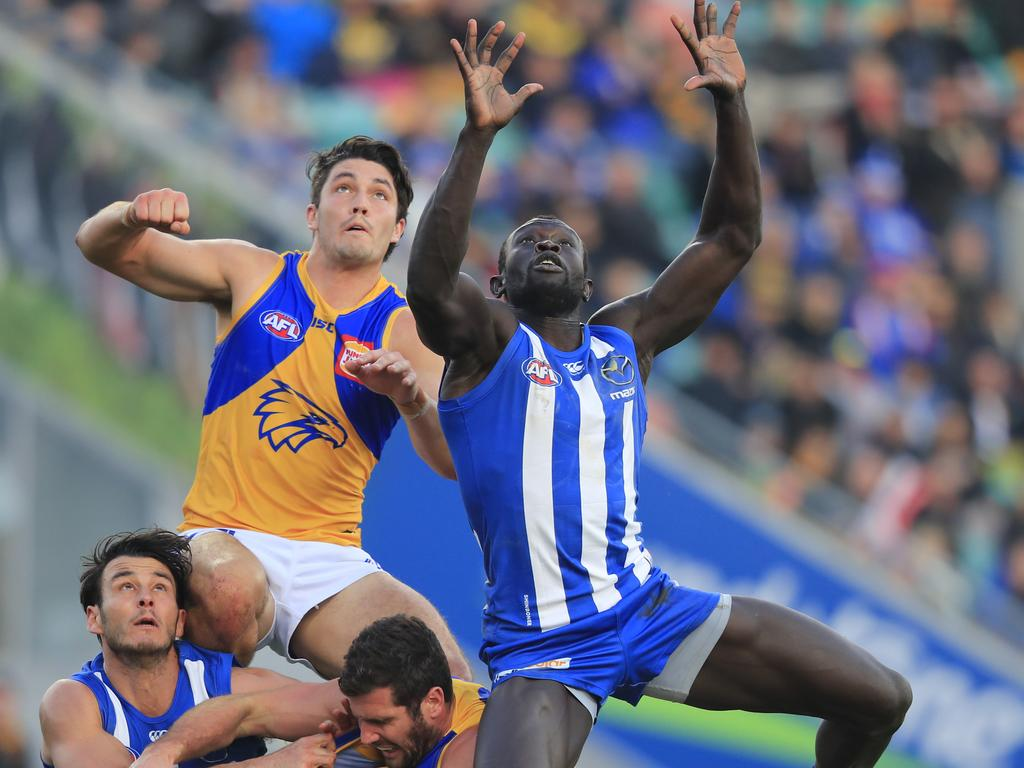 Majak Daw of the Kangaroos (centre) in action during the Round 19 AFL match between the North Melbourne Kangaroos and the West Coast Eagles at Blundstone Arena in Hobart, Sunday, July 29, 2018. (AAP Image/Rob Blakers) NO ARCHIVING, EDITORIAL USE ONLY