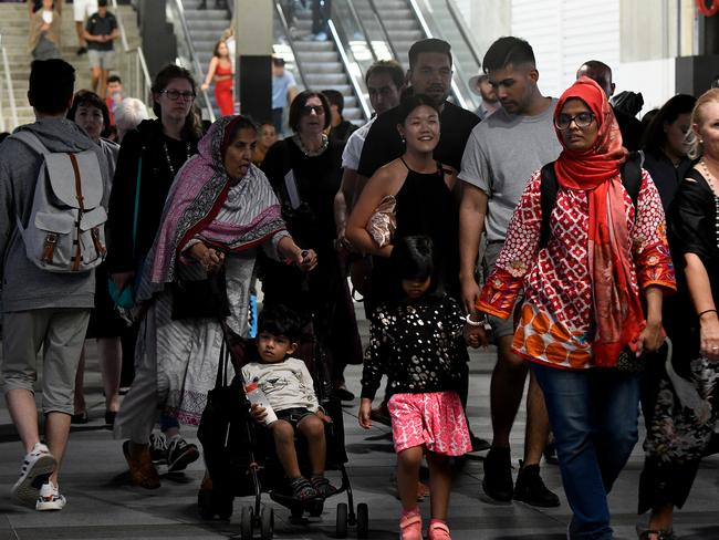 Revellers flood out of Wynyard Station after watching the fireworks. Picture: AAP