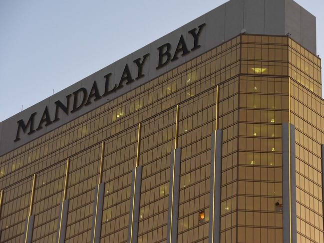 Broken windows that Stephen Paddock fired from in the The Mandalay Bay Hotel and Casino are seen in Las Vegas. Picture: AFP