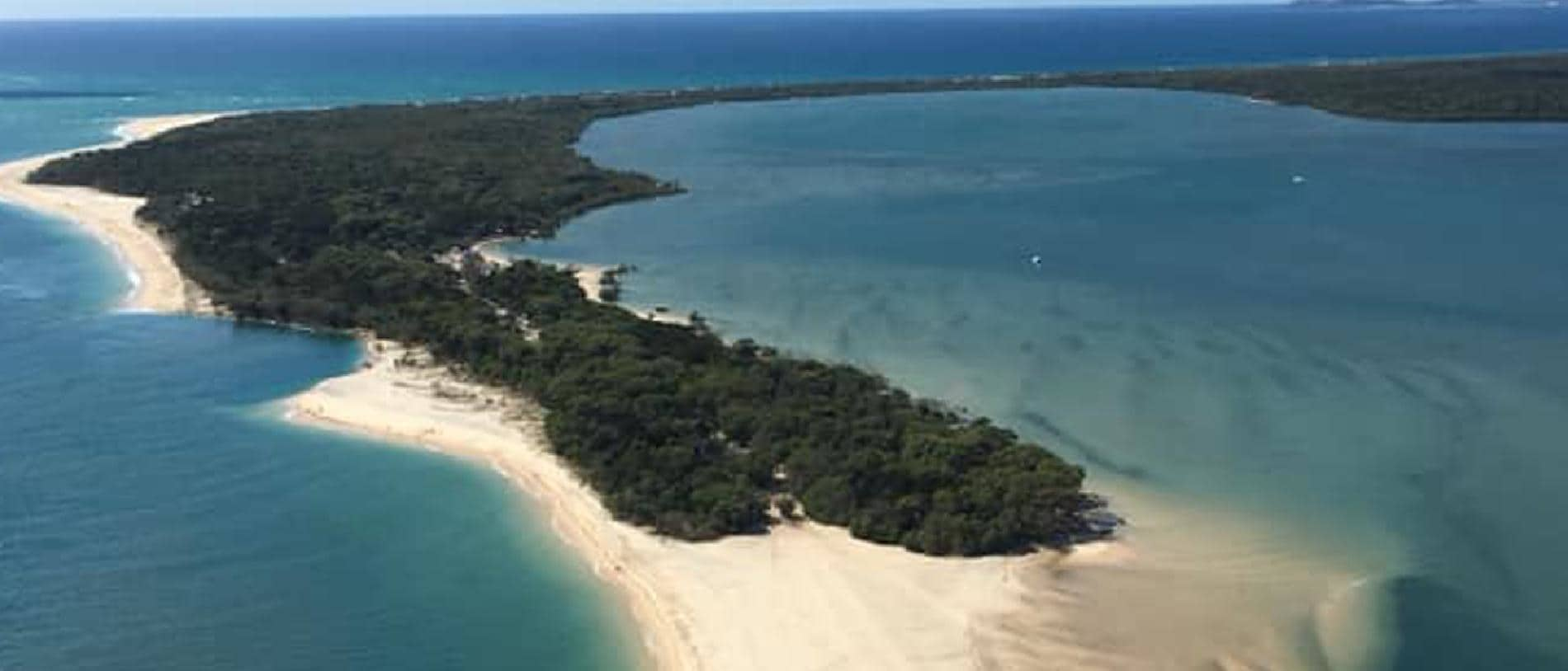 A supplied aerial image of a hole forming at Inskip Point near Rainbow Beach in Queensland. Picture: AAP/ from Rainbow Beach Helicopters