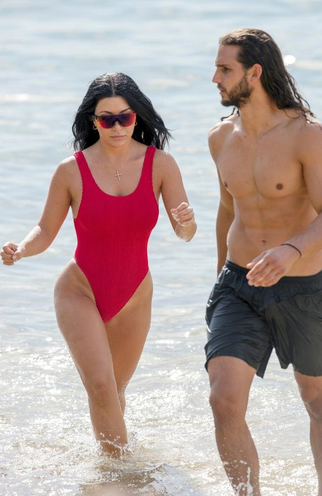 Martha appears to be taking inspiration from Pamela Anderson's Baywatch character in this figure-hugging red swimsuit. Picture: Diimex
