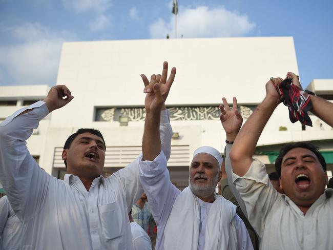 Supporters of Pakistan's cricketer-turned politician and head of the Pakistan Tehreek-e-Insaf (Movement for Justice) Imran Khan, shout slogans after the parliament elected Imran Khan as a Prime Minister of Pakistan, in Islamabad. Picture: AFP