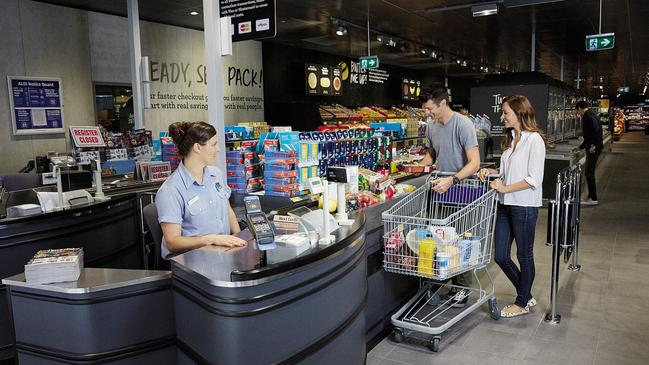 Aldi encourages shoppers to move past the till for packing to keep the checkout pace up.