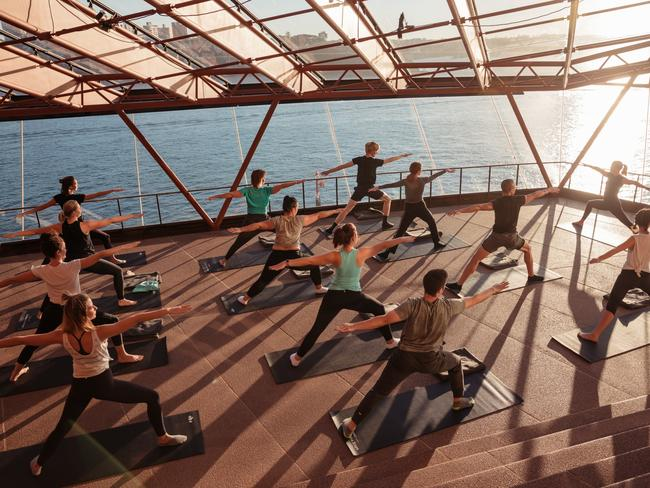 Keep motivated this winter by taking a yoga class with harbour views at Sunrise at the House in July. Picture: Supplied