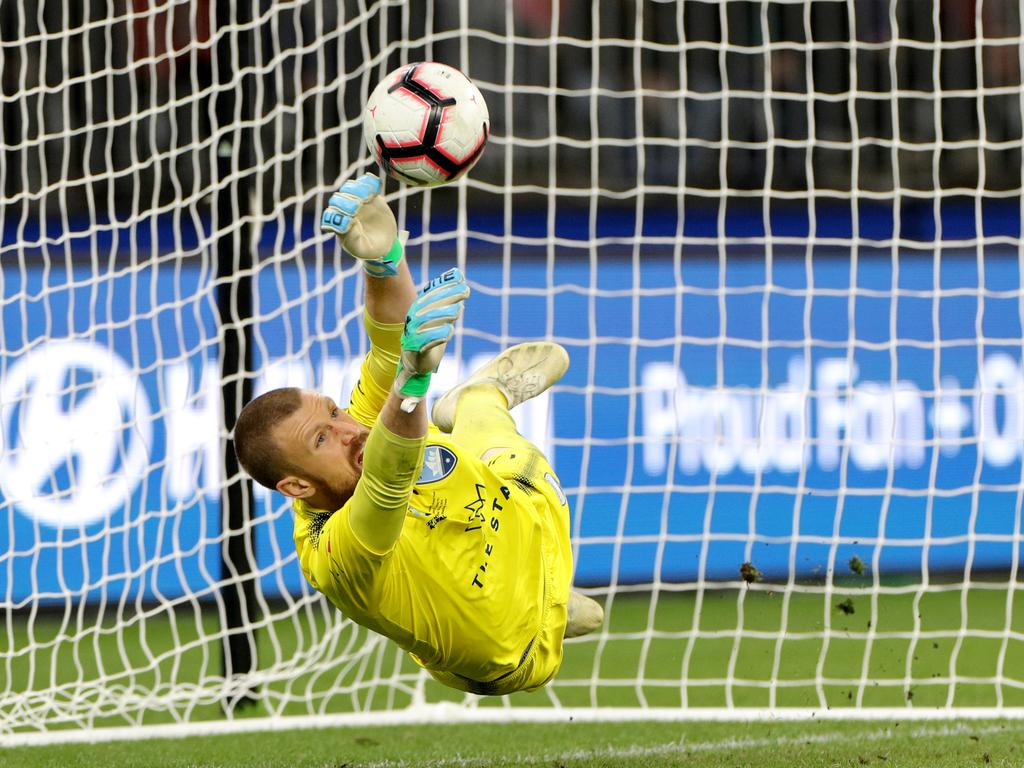 Andrew Redmayne of Sydney saves a penalty kick by Andy Keogh of the Glory during the A-League Grand Final match between the Perth Glory and the Sydney FC at Optus Stadium in Perth, Sunday, May 19, 2019. (AAP Image/Richard Wainwright) NO ARCHIVING, EDITORIAL USE ONLY