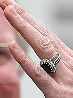 She has been wearing three rings since Prince George's birth. Picture: Ben Stansall/AFP