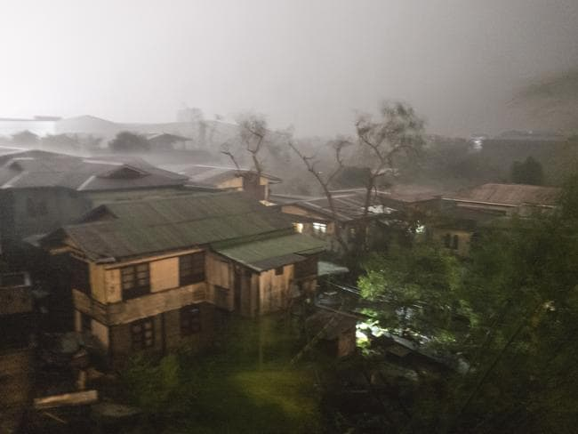 Rains cover the city as strong winds batter houses and buildings lying on the path of Typhoon Mangkhut. Picture: Jes Aznar