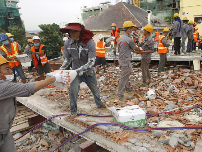Rescue workers to remove rubble at the site of a collapsed building in Cambodia. Picture: AP