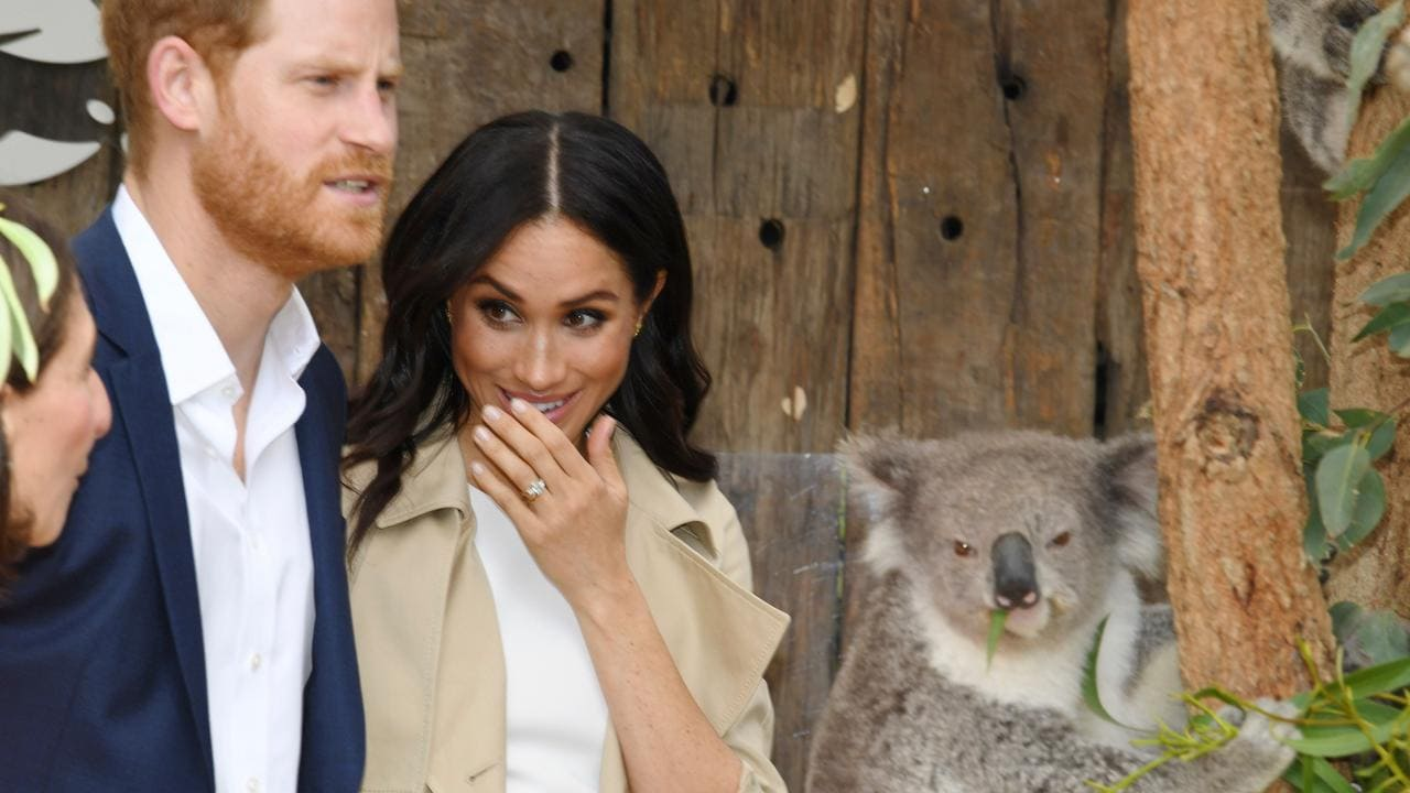 The royal couple meet a koala named Ruby and its koala joey named Meghan, after the Duchess of Sussex, during a visit to Taronga Zoo in Sydney on Tuesday. Picture: AFP