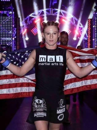 Entering an arena with the American flag.