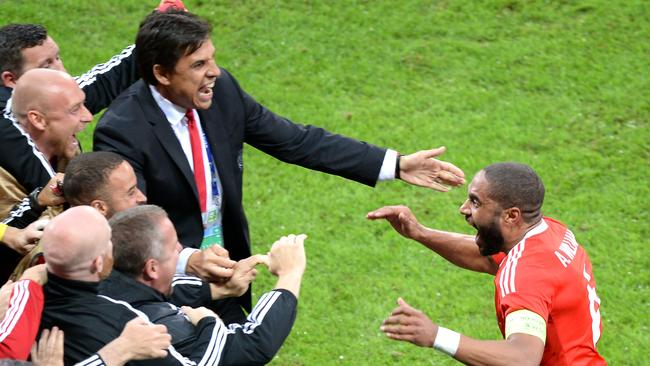 Wales' defender Ashley Williams (R) celebrates with Wales.