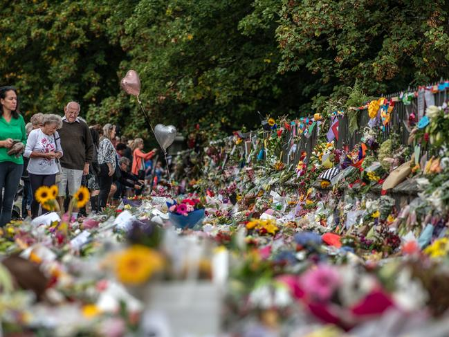 People view flowers and tributes by the Botanical Gardens in Christchurch. Picture: Getty Images