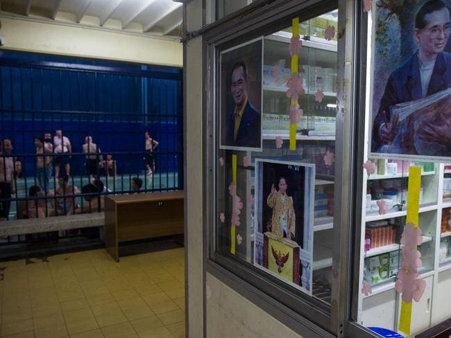A clinic for foreign detainees decorated with portraits of late Thai King Bhumibol Adulyadej. John said they were given medicine once a week. Picture: Romeo Gacad/AFP