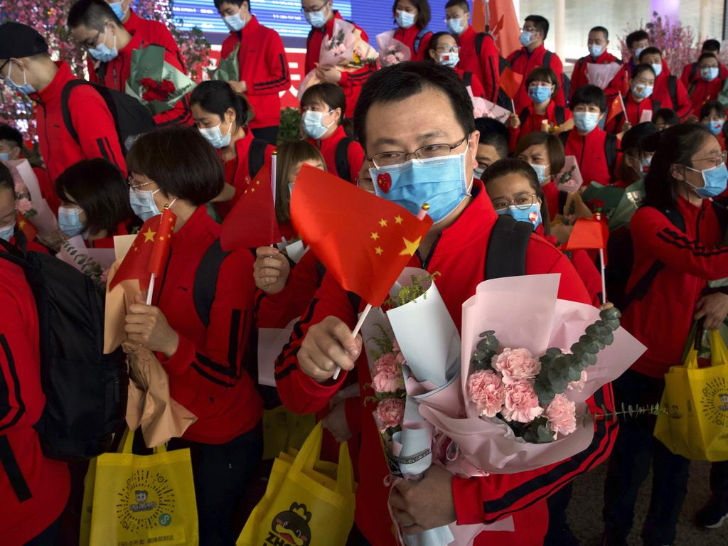 Medical workers from China's Jilin Province react as they prepare to return home at Wuhan Tianhe International Airport. Picture: AP