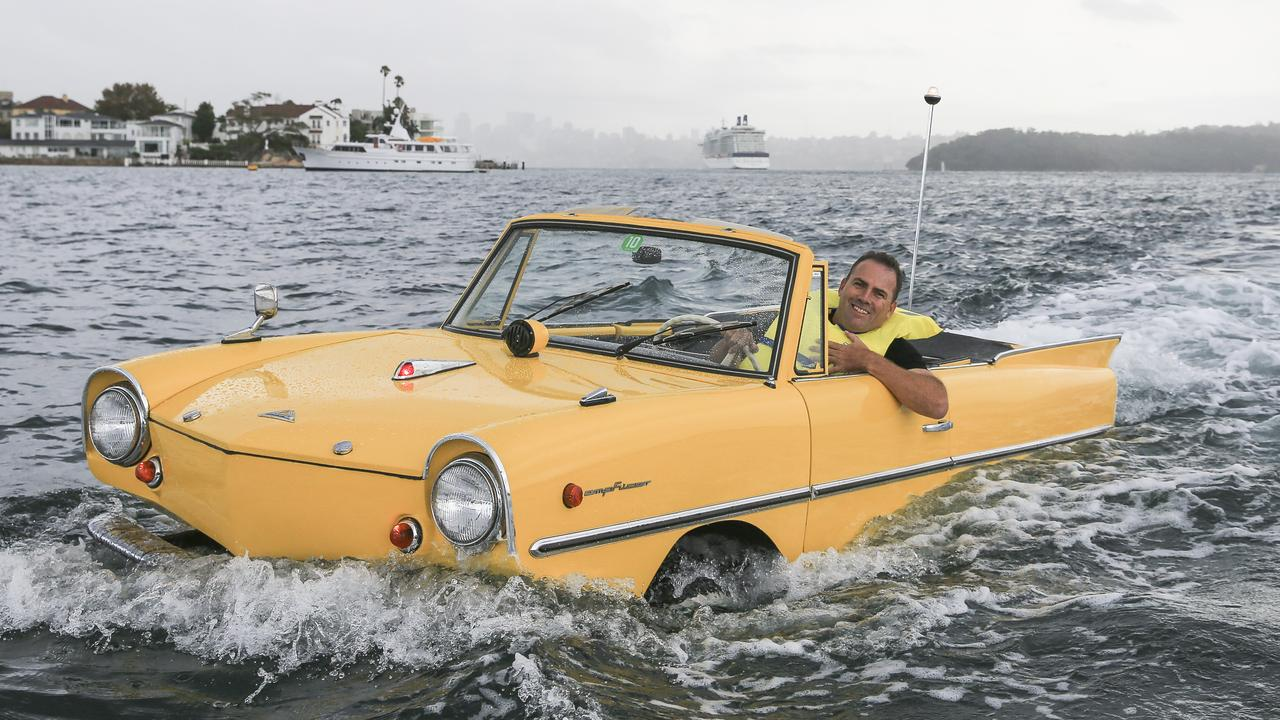 Jason Fischer drives the 1966 Amphicar 770. Picture: Dylan Robinson