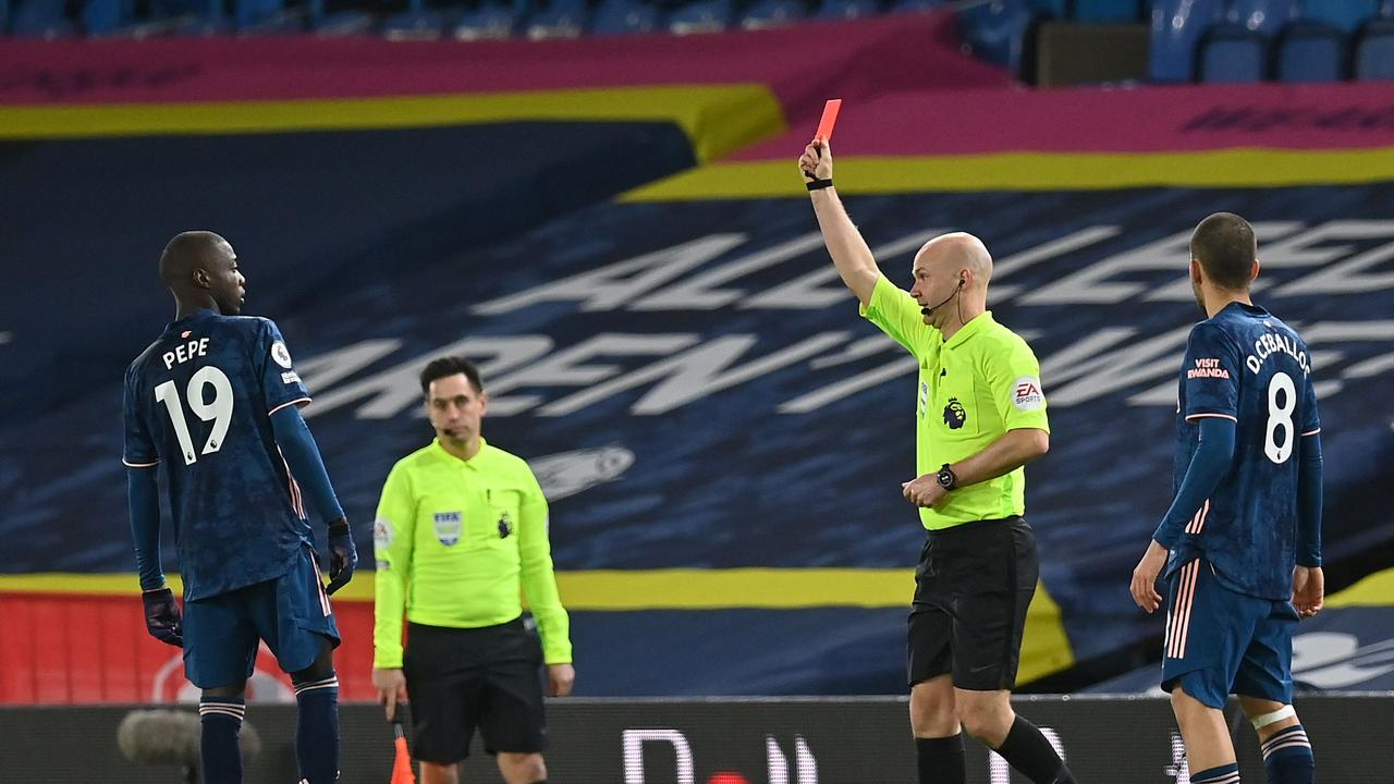 Pepe is shown a red card by Anthony Taylor.