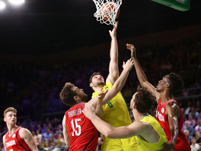 Australian guard Mitch Norton takes on the Canadians in the gold medal match. (Ryan Pierse/Getty Images)