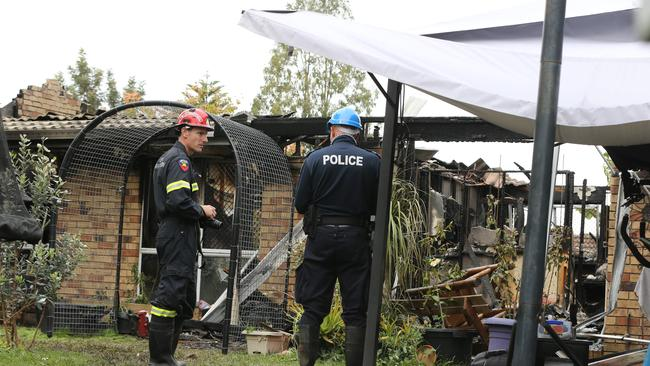 Police and emergency services at the scene of a house fire in Mercator Court Carrara. Picture Glenn Hampson