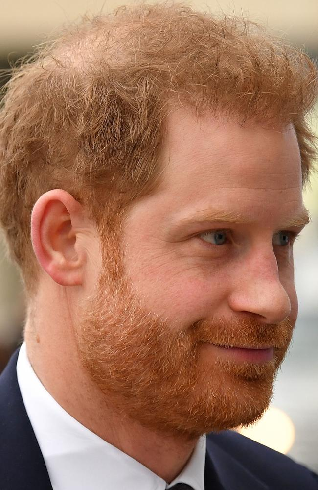 Hair to the throne … can Prince Harry hold onto his locks? Picture: AFP