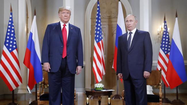 The US President and Russian President pose for a photograph at the beginning of a one-on-one meeting at the Presidential Palace in Helsinki, Finland on Monday. Picture: Pablo Martinez Monsivais/AP
