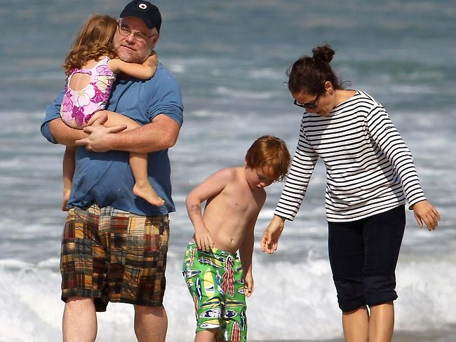 Family man ... Philip Seymour Hoffman holds his three year old daughter Tallulah as son Cooper and partner Mimi O'Donnell hang out on Bondi beach. Picture: Big Pictures