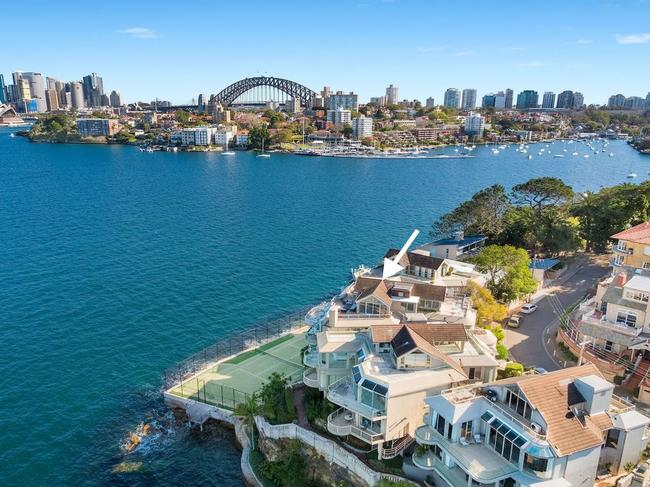 The penthouse is split over two levels and has cracking views of Sydney Harbour