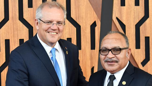 Peter O'Neill (R) with Scott Morrison at APEC in November 2018. Picture: AFP
