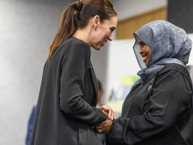 Jacinda Ardern greets a first responder after Friday's massacre. Picture: Kai Schwoerer/Getty Images