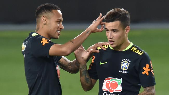 Brazil's Neymar (L) and Philippe Coutinho in Brazil training.