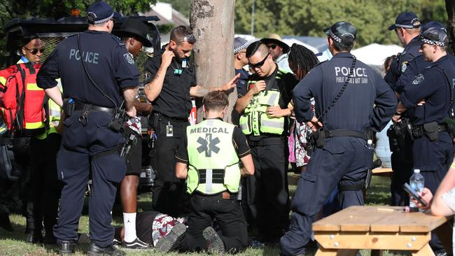 A man is treated by medics at the FOMO festival in western Sydney and taken away in a buggy for medical treatment. Picture: David Swift
