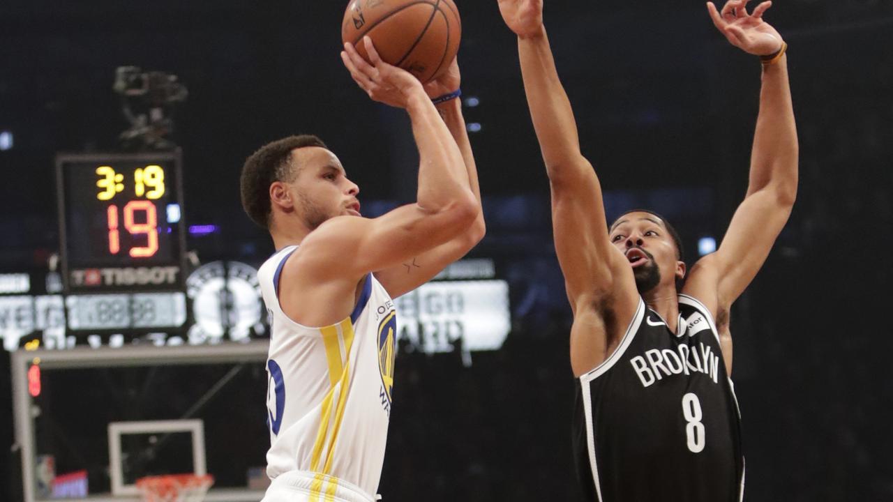 90bdb424861 Golden State Warriors' Stephen Curry, left, shoots over Brooklyn Nets'  Spencer Dinwiddie