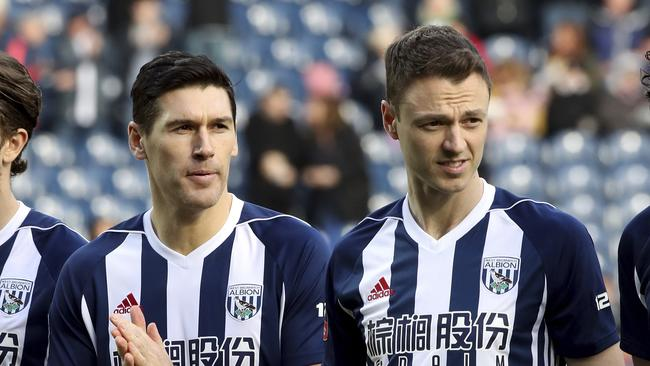 Jonny Evans (R) was stripped of the West Brom captaincy after his antics in Barcelona