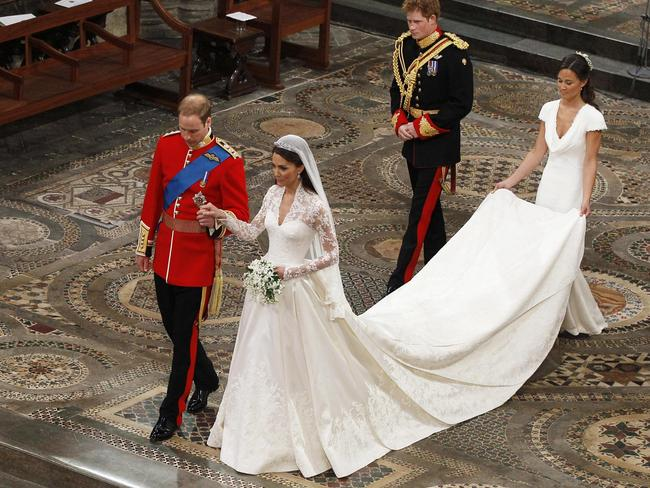 Prince William takes the hand of his bride Catherine Middleton followed by Prince Harry and Pippa Middleton as they walk down the aisle inside Westminster Abbey on April 29, 2011. Picture: Getty