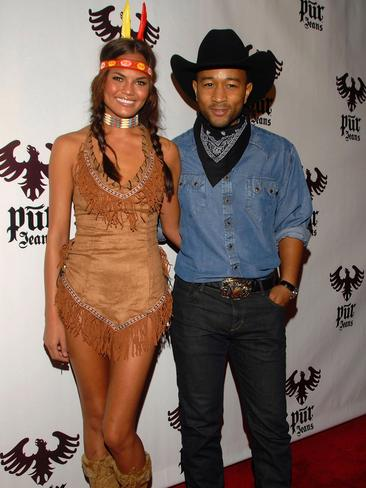 Model Chrissy Teigen and husband John Legend attends the Pur Jeans Halloween Bash in 2008.