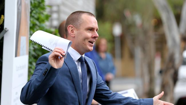 McGrath, Geelong agent Will Ainsworth auctions a property. Picture: Mike Dugdale